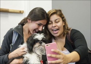 Sparky dog and students taking a selfie
