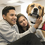Students playing with a therapy dog.