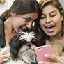 Two Students Taking a Selfie with a Therapy Dog