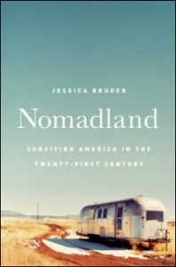 Nomadland title and an RV in the desert
