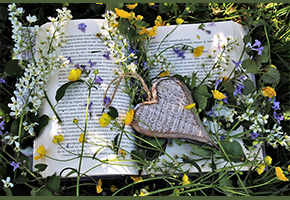 Book, flowers and heart emblem