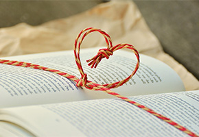 Book with a heart shaped bow