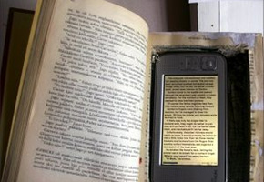 A book and a cellphone with book text on them.