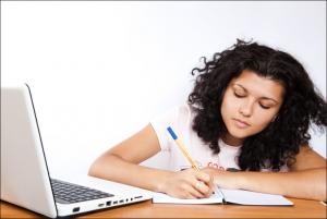girl studying at laptop