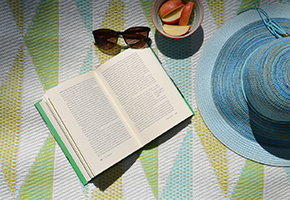 book, sunglasses, apple slices, sunhat