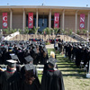 Image of CSUN's commencement, graduates in front of the library