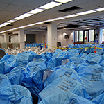 A Sea of Blue Plastic -- Getting Ready to Unpack our Furniture