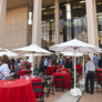 After the ribbon-cutting ceremony, guests mingle and partake in refreshments