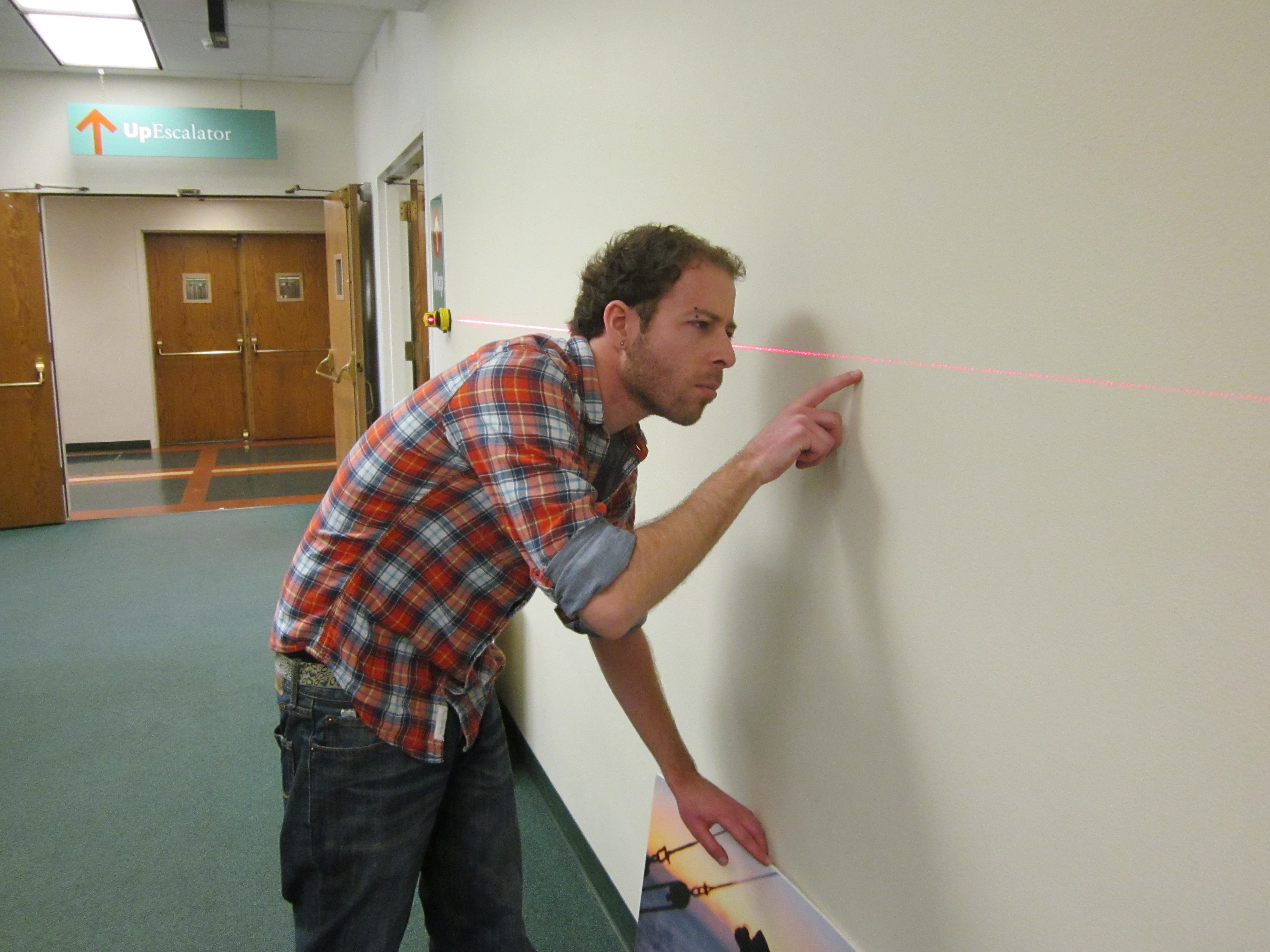 Mounting the exhibition.  Student assistant Tim Kaufler finds the exact spot