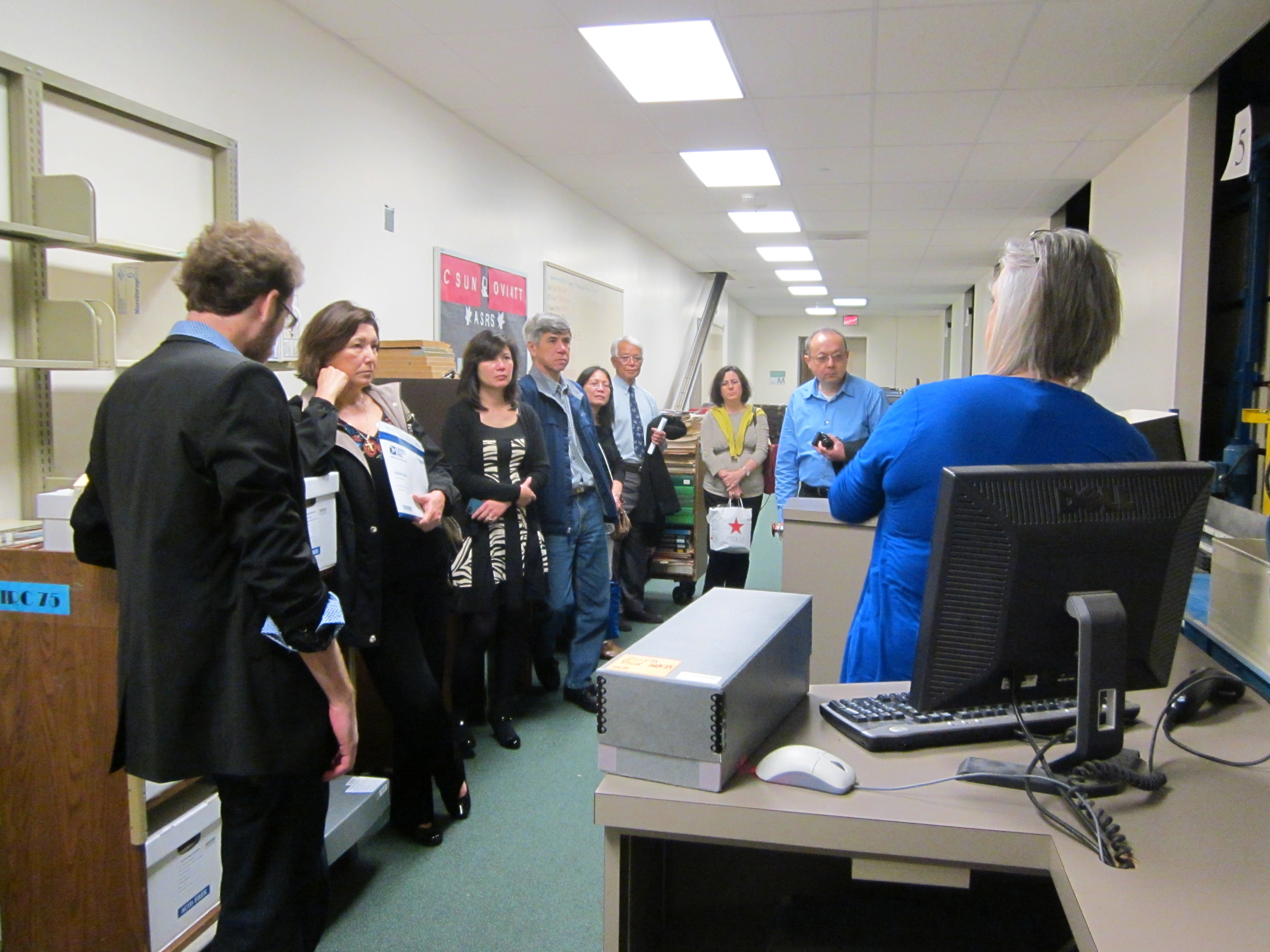 Visitors from Northern California are introduced to the automated storage system by Project Archivist Vicki Schmidtberger