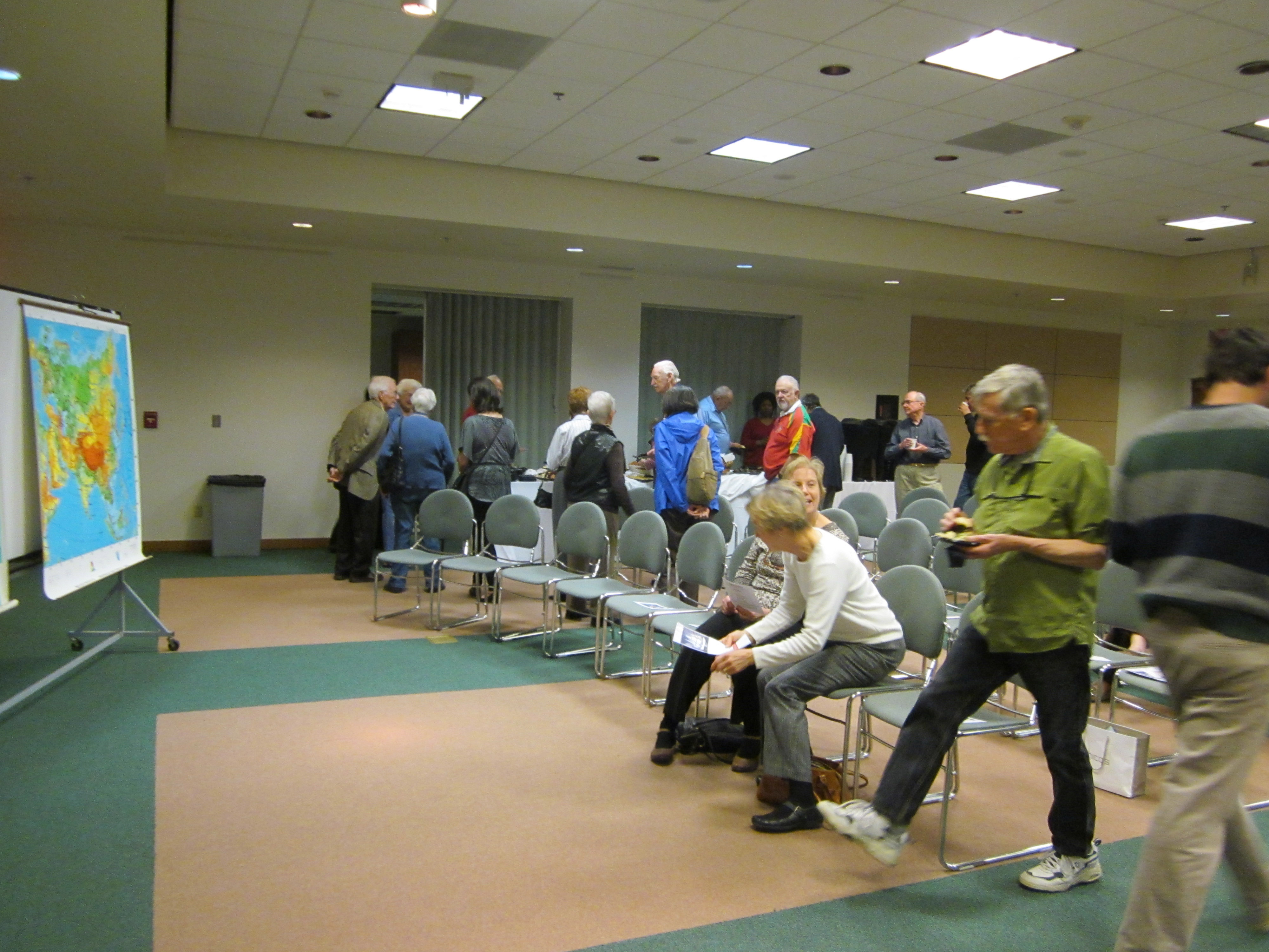 Guests at the opening event gather for lectures and refreshments