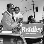 Tom Bradley with child campaigning for mayor