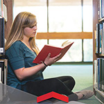 Student Reading in the Oviatt Library