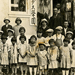 Children outside a school in a japanese internment camp.