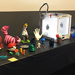 Table with 3D printer and 3D printed objects