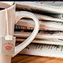 cup of tea and newspapers