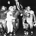 Members of the Matador football team carry Coach Sam Winningham of the field, ca. 1966. University Archives Photograph Collection
