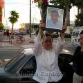 Blanca Martinez raises the photograph of her murdered husband, Armando Rodriguez, Juárez, 2008
