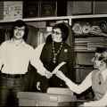 Candidate, Joy Picus looks on as her son Mark hands his ballot to an unidentified polling place assistant, 1973.
