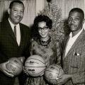 Brad Pye, Jr. and unidentified people, LA Sentinel, 1964