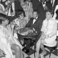 The Supremes (L-R) Mary Wilson, Diana Ross and Florence Ballard, sitting with boss, Berry Gordy, president of Motown Record Corp. Harry Adams Collection