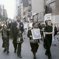 Reverend Pat Bumgartner leads the procession to Port Authority bus terminal.