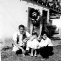 Paula, Alfredo, Alfredo Jr., and Armida Lopez in front of their Pacoima home, circa 1955