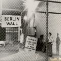 "Chain link fence with sign that reads ""Berlin Wall"" during lockout at Herald-Examiner Building, downtown Los Angeles, ca. 1969. Paul Kelly, Los Angeles Typographical Union, Local 174 Collection."