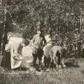 Family enjoying outdoor activities, ca. 1922