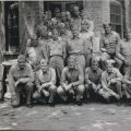 Maj. James C. Magee (front row center) poses with his battalion staff at British Embassy compound billet, Peking 1945. William J. Parker China Marines Association Collection, 1929-2010.