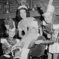 Christmas celebration with former boxing heavyweight champion of the world James (Jim) Jeffries as Santa Claus and Miss Burbank, Debbie Reynolds (on the left), 1948