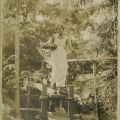 Photograph of an unidentified woman standing on a bridge, ca. 1910. Donald Hiram Stilwell Photograph Collection