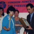 State Senator, Richard Alarcon, gives Maria Reza an award, July 1999