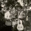 Two men displaying guitars. Man on right wearing a blazer. Vahdah Olcott-Bickford Collection