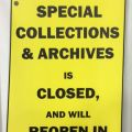 "Sign, ""Special Collections and Archives is closed and will reopen in August."""