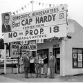 "Campaign associates in front of the Van Nuys field office for the ""No on Proposition 18"" campaign, located at 1433 Vanowen Boulevard, 1958."