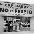 "Campaign associates in front of the Canoga Park field office for the ""No on Proposition 18"" campaign, located at 7211 Remmet Street, 1958."