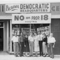 "Campaign associates in front of the Pacoima field office for the ""No on Proposition 18"" campaign, located at 13535 Van Nuys Boulevard, 1958."