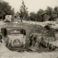 Montrose Flood, 1934, a partially buried automobile, Little Landers Historical Society. San Fernando Valley History Digital Library.