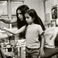 Marla, painting, with her daughter, Queens, New York.