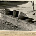 "Photograph of outdoor water heating. ""Primitive method of heating water for approximately fifty people."""
