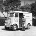 Adohr Farms delivery truck and milkman, ca. 1936