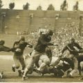 Scrapbook page photograph of Occidental College football players in action, ca. 1920s