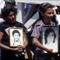 Two grieving women await Pope John Paul II, Managua, Nicaragua, 1983