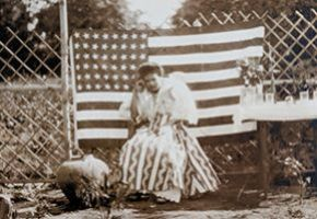 Unidentified woman in front of forty-eight star American flag, ca. 1912.