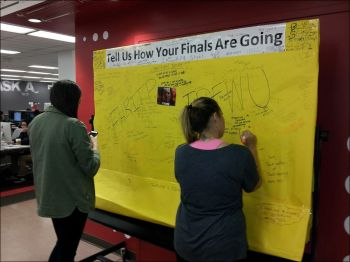 students using graffiti board