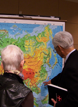 Members of the public look at a map