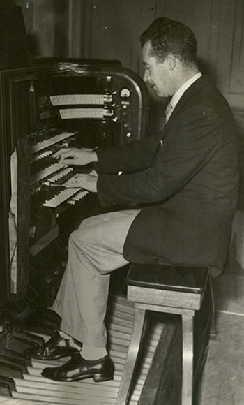 Brindle playing the organ