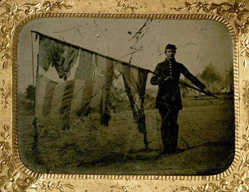 Union soldier with tattered US flag