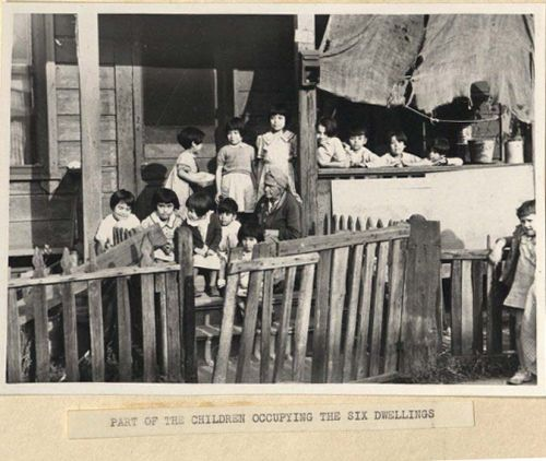 Photograph of children and elder from Poor Housing Conditions in Los Angeles